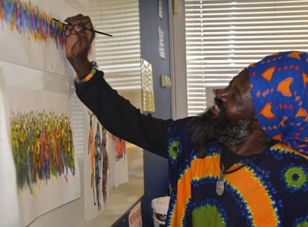 Kwame demonstrating African Art