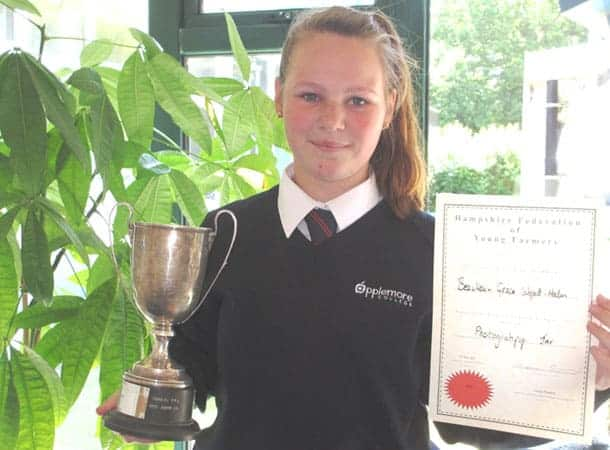 Grace with trophy and certificate