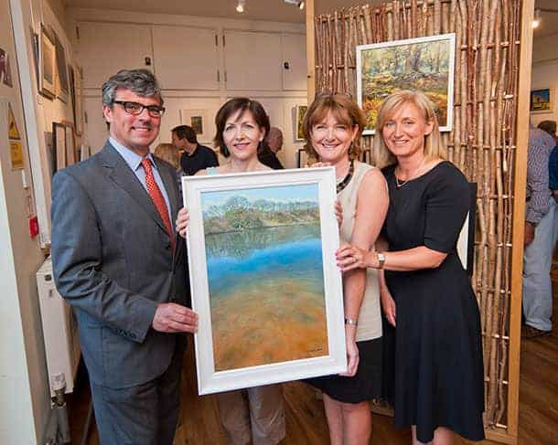 Pictured left to right at the Open Art exhibition preview evening: New Forest National Park Authority chairman Oliver Crosthwaite-Eyre; open art competition winner Andrea Hook with her painting 'Eyeworth Pond'; New Forest centre manager Hilary Marshall; Alison Jones, community affairs manager with competition sponsor ExxonMobil at Fawley
