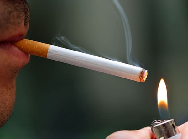 Man lighting up a cigarette