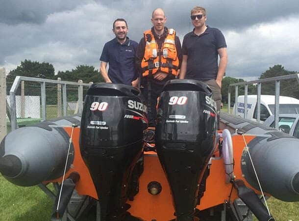 From left to right: Solent Rescue's Sam Drummond, Lee Cooper and Rob Benneyworth with the new boat engines.