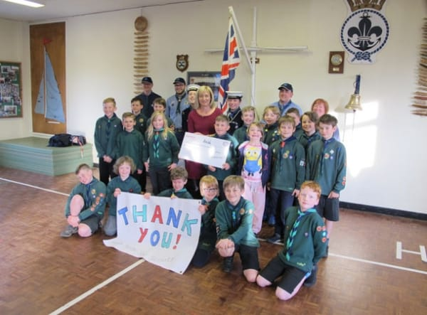 Alison Jones, Community Affairs Manager at ExxonMobil Fawley, presents a cheque for £2,000 to Hythe Sea Scouts.