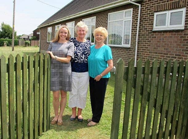 Pictured: Angharad Vaughan, Iris Cottrell and Di Hobson next to the new fence.