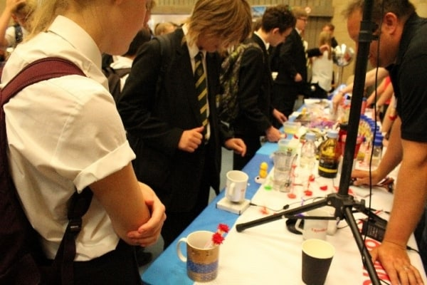 Students with ExxonMobil Fawley learning about their technology and floating cups.