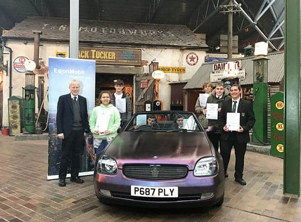 Lord-Montagu-with-the-young-mechanics-and-the-car-they-renovated-during-the-10-week-Mechanix-course